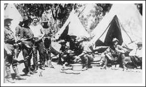 John Simpson with friends at camp (AWM A03116)